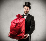 Hansome man with a present Stock Images