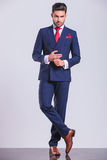 Hansome man in suit with legs crossed while touching hands Stock Photography