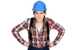Hantverkerska som ser ilsken Arkivfoto