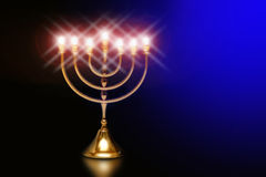 Hanuka menorah. A shining hanukkah menorah in the darkblue background Royalty Free Stock Image