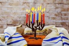 Hanuka menorah with burning candles. Jewish holiday hannukah challah bread Stock Photo
