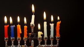 Hanukah candles celebrating the Jewish holiday stock video
