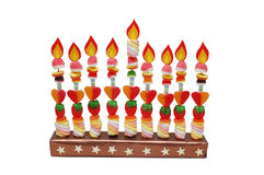 Hanukah menorah made from candies with paper flame. S isolated on white stock images