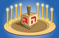 Hanukkah świeczki z tradycyjną wierzchołek zabawką Fotografia Stock