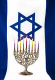 Hanukkah. Menorah with Israeli flag Stock Images