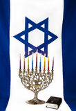 Hanukkah. Menorah with Israeli flag Royalty Free Stock Photography