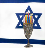 Hanukkah. Menorah with Israeli flag Stock Photography