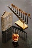 Hanukkah. A hanukiah, dreidel and prayer book for Hanukkah Royalty Free Stock Image