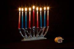 Hanukkah. Menorah with candles and dreidel Royalty Free Stock Photos