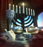 Hanukkah background with candles, donuts, spinning top. Hanukkah composition with candles, donuts, spinning top royalty free stock photography
