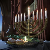 Hanukkah background with candles, donuts, spinning top and old books Stock Image