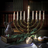 Hanukkah background with candles, donuts, spinning top and old books Stock Photos