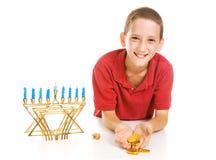 Hanukkah Boy Holding Gelt Royalty Free Stock Image