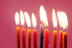 Hanukkah  burning candles on the pink background Royalty Free Stock Image