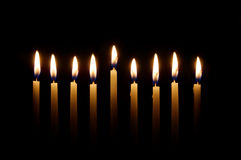 Hanukkah Candles. Glowing candles lit for the eighth night of Hanukkah royalty free stock image