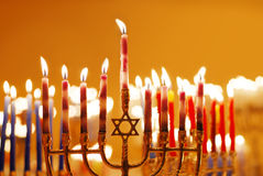 Hanukkah Candles. Brightly lit grouping of menorahs on the eighth night of Hanukkah Stock Photos
