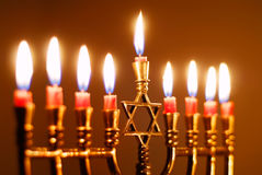 Hanukkah Candles. Brightly lit menorah on the eighth night of Hanukkah Royalty Free Stock Images