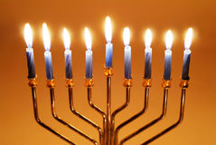 Hanukkah Candles. Brightly lit menorah on the eighth night of Hanukkah stock photos