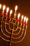 Hanukkah Candles. Brightly lit menorah on the eighth night of Hanukkah stock images