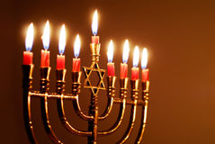 Hanukkah Candles. Star of David menorah lit for the eighth night of Hanukkah stock image