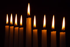 Hanukkah Candles. All candle light on the traditional Hanukkah menorah royalty free stock photography