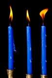 Hanukkah candles on black background. Burning hanukkah candles in a menorah on black background