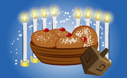 Hanukkah candles with traditional donuts Royalty Free Stock Photo