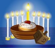 Hanukkah candles with traditional donuts. And top toy