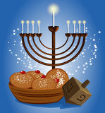 Hanukkah candles with traditional donuts Royalty Free Stock Image