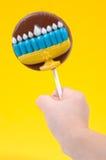 Hanukkah Candy. Hand Holding a Hanukkah Lollipop
