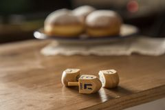 Hanukkah Celebration Concept-dreidels on the Rustic table with D. Still life for jewish holiday Hanukkah with Hanukkah Celebration Concept-dreidels on the Rustic royalty free stock image