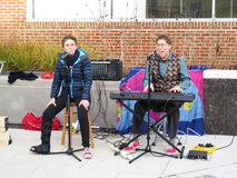 Hanukkah Celebration Entertainment in Washington DC. Photo of man and woman musicians singing popular hanukkah tunes at a jewish hanukkah celebration at stock image