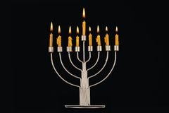Hanukkah celebration with menorah and candles. Isolated on black Royalty Free Stock Photos