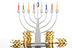 Hanukkah celebration with menorah. Candles and coins,  isolated on white Stock Image