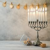 Hanukkah celebration with menorah. And spinning top on wooden table
