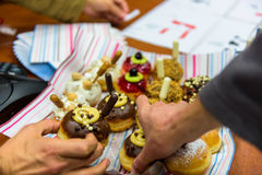 Hanukkah celebration with various decorated donuts. (Sufganiyah