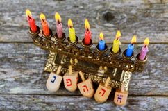 Hanukkah Chanukah Jewish holiday background with Hanukah Chanukkah menorah Judaism candelabra burning candles and traditional Stock Images