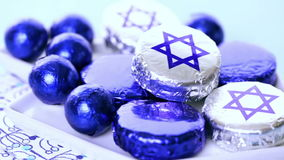 Hanukkah. Chocolates with Star of David for Hanukkah stock video