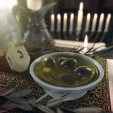 Hanukkah close up with candles, old books, spinning top Royalty Free Stock Image