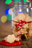 Hanukkah Cookies and Lights. A jar of Hanukkah ( or holiday ) cookies with out of focus lights in background Royalty Free Stock Image