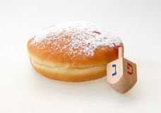 Hanukkah doughnut and spinning top Royalty Free Stock Images