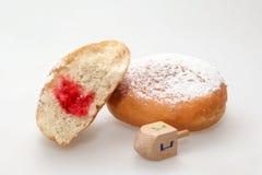 Hanukkah doughnut and spinning top Stock Photos