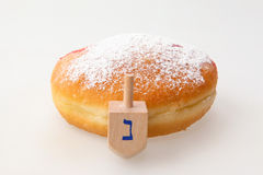 Hanukkah doughnut and spinning top Royalty Free Stock Image
