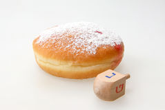 Hanukkah doughnut and spinning top Stock Photography