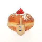 Hanukkah doughnut and spinning top Stock Image