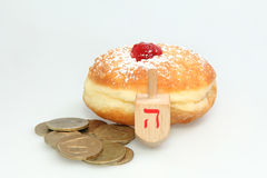 Hanukkah doughnut and spinning top Royalty Free Stock Photography