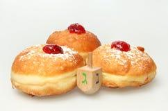 Hanukkah doughnut and spinning top Stock Photo