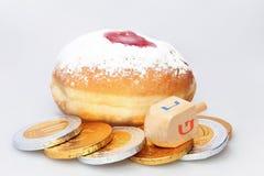 Hanukkah doughnut and spinning top Royalty Free Stock Photos