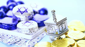 Hanukkah. Dreidel and gelt on the table stock footage