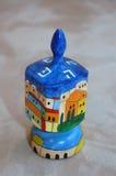 Hanukkah dreydl. Toy with picture of Jerusalem